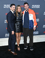 "10 June 2019 - Westwood, California - Luis Gerardo Méndez, Adam Sandler, Jennifer Aniston. Netflix's ""Murder Mystery"" Los Angeles Premiere held at Regency Village Theater. Photo Credit: Birdie Thompson/AdMedia"
