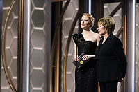 Emma Stone and Shirley MacLaine on stage at the 75th Annual Golden Globe Awards at the Beverly Hilton in Beverly Hills, CA on Sunday, January 7, 2018.<br /> *Editorial Use Only*<br /> CAP/PLF/HFPA<br /> &copy;HFPA/PLF/Capital Pictures