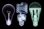 X-ray image of incandescent, CFL, LED bulbs (color on black) by Jim Wehtje, specialist in x-ray art and design images.