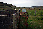A weighing machine at a disused sheep pen on the the Inner Hebridean island of Colonsay on Scotland's west coast.  The island is in the council area of Argyll and Bute and has an area of 4,074 hectares (15.7 sq mi). Aligned on a south-west to north-east axis, it measures 8 miles (13 km) in length and reaches 3 miles (4.8 km) at its widest point, in 2019 it had a permanent population of 136 adults and children.