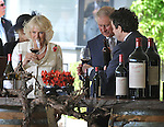 AUSTRALIA, Adelaide : Britain's Prince Charles (C) and his wife Camilla (L) try the Penfold Grange wine with Chief winemaker Peter Gago (R) during a tour of the Penfolds Magill Estate Winery in Adelaide on November 7, 2012. The royal couple are on a 6-day visit to Australia to commemorate the Diamond Jubilee of Queen Elizabeth II. AFP PHOTO/POOL/Mark GRAHAM