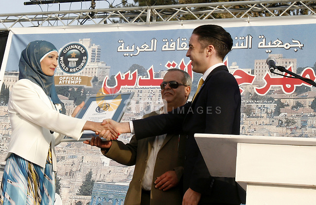 British Jack Brockbank , an international adjudicator from Guinness World Records, presents a certificate to Greek Orthodox Archbishop Theodosios (Atallah) Hanna for the longest buffet of natural and organic food setting a new guinness world record, on May 26, 2012 in Arab east jerusalem. The Palestinian banquet, prepared by Jerusalem locals, measured 202 metres. Photo by Mahfouz Abu Turk