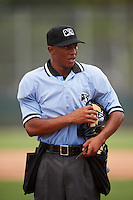 Umpire Thomas Burrell during a game between the GCL Phillies and GCL Pirates on August 6, 2016 at Pirate City in Bradenton, Florida.  GCL Phillies defeated the GCL Pirates 4-1.  (Mike Janes/Four Seam Images)