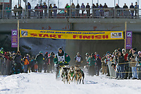 Buddy Streeper at the start of day three of the oldest continuously run sled dog race in the world, the 2003 Open North American Sled dog championships which start on the Chena River in downtown Fairbanks, Alaska. The annual race consists of three daily races, the combined fastest time wins.