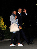 United States President Barack Obama waves as he departs the White House for a vacation in Hawaii on Friday, December 19, 2014. President Obama is with his daughter Sasha.  <br /> Credit: Dennis Brack / Pool via CNP