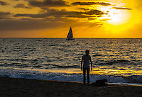 Fine Art Print Photograph, Sunset Walking the dog in Banderas Bay, Puerto Vallarta, Mexico. Sailboat passes by the setting sun.