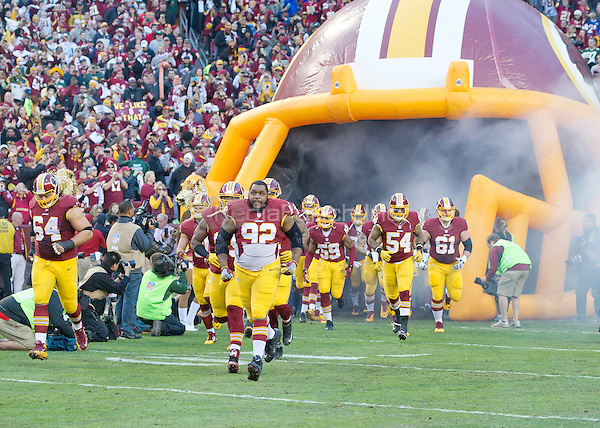 The Washington Redskins, led by Washington Redskins defensive end Chris Baker (92), run onto the field as they are introduced prior to the NFC Wild Card game against the Green Bay Packers at FedEx Field in Landover, Maryland on Sunday, January 10, 2016.<br /> Credit: Ron Sachs / CNP/MediaPunch ***FOR EDITORIAL USE ONLY***
