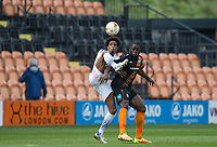 Sido Jombati of Wycombe Wanderers and John Akinde of Barnet during the Sky Bet League 2 match between Barnet and Wycombe Wanderers at The Hive, London, England on 17 April 2017. Photo by Andy Rowland.