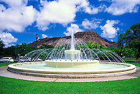 The Dillingham Fountain can be found at the southern end of Kapiolani Park near the base of the famous Diamond Head Crater. Diamond Head in background.