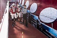 Oklahoma quarterback Trevor Knight (9), defensive tackle Chuka Ndulue (98) accompanied by game official Gene Seiko arrive for ceremonial coin toss before NCAA football game against Baylor, Saturday, November 08, 2014 in Norman, Tex. (Mo Khursheed/TFV Media via AP Images)