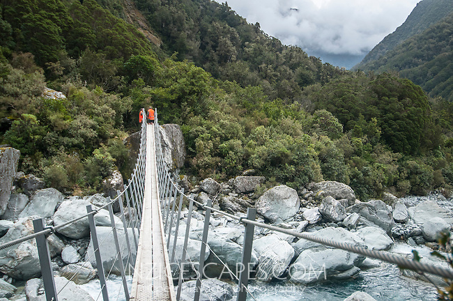 DOC workers maintaining swingbridge over Butler River South Branch near Whataroa, South Westland, West Coast, New Zealand