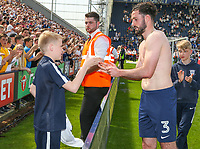 Preston North End's Greg Cunningham gives his short to a young fan <br /> <br /> Photographer Alex Dodd/CameraSport<br /> <br /> The EFL Sky Bet Championship - Preston North End v Burton Albion - Sunday 6th May 2018 - Deepdale Stadium - Preston<br /> <br /> World Copyright &copy; 2018 CameraSport. All rights reserved. 43 Linden Ave. Countesthorpe. Leicester. England. LE8 5PG - Tel: +44 (0) 116 277 4147 - admin@camerasport.com - www.camerasport.com