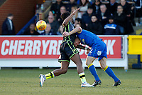 Barry Fuller of AFC Wimbledon and Ellis Harrison of Bristol Rovers contest the ball during the Sky Bet League 1 match between AFC Wimbledon and Bristol Rovers at the Cherry Red Records Stadium, Kingston, England on 17 February 2018. Photo by Carlton Myrie.