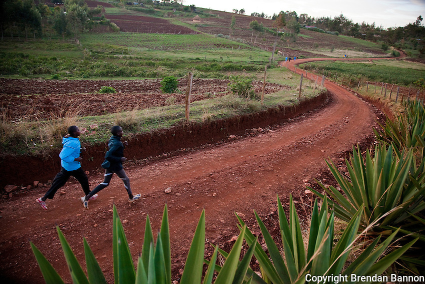 Runners training  on a dirt road in Iten, Kenya. Runners from the area are joined by Kenyans from other regions as well as international atheletes. The high altitude training helps runners  excel at lower altitudes.