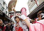 "Participants carry a portable shrine on which is mounted a 2.5 meter pink phallus in the grounds of Wakamya Hachimangu shrine during the Kanamara Festival in Kawasaki, Japan on 04 April 2010. The fertility festival, often just called the ""penis festival,"" has been held since the early 1600s. Today, the festival also aims to promote awareness of AIDS and STDs"