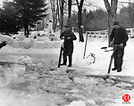 Dominic Kowaleski, left, and William Batick are shown cutting ice on Johnson's Pond in Thomaston  in the 1930s.