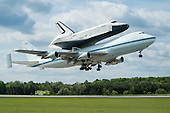 Space shuttle Enterprise, mounted atop a NASA 747 Shuttle Carrier Aircraft (SCA), is seen as it takes off for New York from Washington Dulles International Airport, Friday, April 27, 2012, in Sterling, Virginia. Enterprise was the first shuttle orbiter built for NASA performing test flights in the atmosphere and was incapable of spaceflight. Originally housed at the Smithsonian's Steven F. Udvar-Hazy Center, Enterprise will be demated from the SCA and placed on a barge that will eventually be moved by tugboat up the Hudson River to the Intrepid Sea, Air & Space Museum in June. .Mandatory Credit: Mark Avino / NASA/Smithsonian Institution via CNP