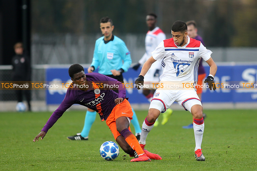 Hamza Rafia of Olympique Lyonnais tackles Manchester City's Taylor Richards during Lyon Under-19 vs Manchester City Under-19, UEFA Youth League Football at Groupama OL Academy on 27th November 2018