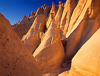 Tent Rocks National Monument, NM <br /> Warm light on cone shaped rocks of eroded volcanic ash at Kasha-Katuwe Tent Rocks National Monument