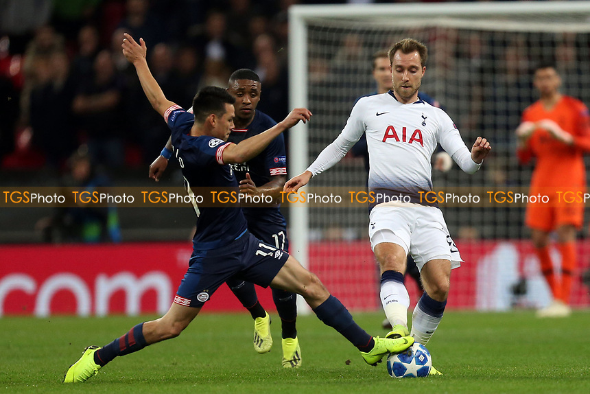 Hirving Lozano of PSV Eindhoven and Christian Eriksen of Tottenham Hotspur during Tottenham Hotspur vs PSV Eindhoven, UEFA Champions League Football at Wembley Stadium on 6th November 2018