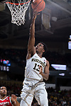 Bryant Crawford (13) of the Wake Forest Demon Deacons drives to the basket for a lay-up during second half action against the North Carolina State Wolfpack at the LJVM Coliseum on February 17, 2018 in Winston-Salem, North Carolina.  The Wolfpack defeated the Demon Deacons 90-84.  (Brian Westerholt/Sports On Film)