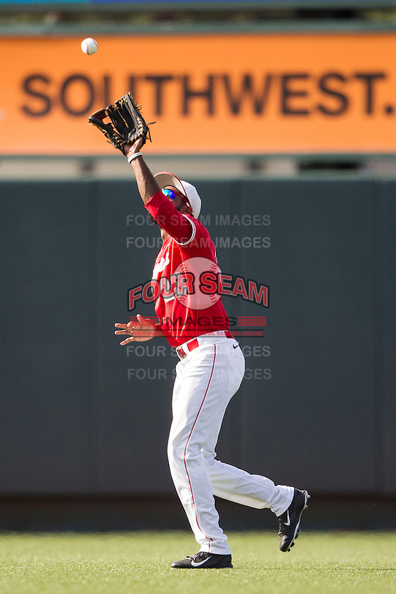 Houston Cougars outfielder Ashford Fuler (23) makes a catch during the NCAA baseball game against the Texas Longhorns on June 6, 2014 at UFCU Disch–Falk Field in Austin, Texas. The Longhorns defeated the Cougars 4-2 in Game 1 of the NCAA Super Regional. (Andrew Woolley/Four Seam Images)