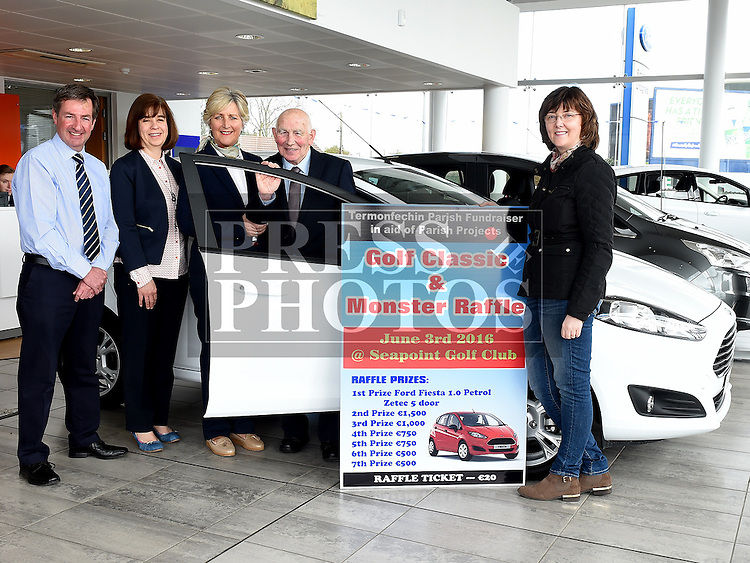 Nicky Smith of Smiths Garage and Termonfeckin Parish Fundraising committee members Ann McEvoy, Eleanor Branigan, Paud Leech and Angela Casey pictured at the launch of their golf classic and monster car draw at Smith Garage. Photo:Colin Bell/pressphotos.ie