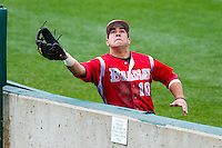 Mike Tauchman (10) of the Bradley Braves attempts to catch a ball in foul territory during a game against the Missouri State Bears on May 13, 2011 at Hammons Field in Springfield, Missouri.  Photo By David Welker/Four Seam Images