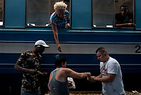 RINCON, CUBA - FEBRUARY 8: Cubans buy food during a stop at Rincon train station on February 8, 2018 in Cuba. Ferrocarriles de Cuba, is one of the oldest railroad around world, having opened its first route in 1837 with at least 17-mile long. Now the railway probably could cover more than 2,600 miles along the Island. (Photo by Eliana Aponte/VIEWpress)