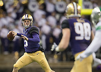 Jake Browning looks for Will Dissly after escaping the pocket.