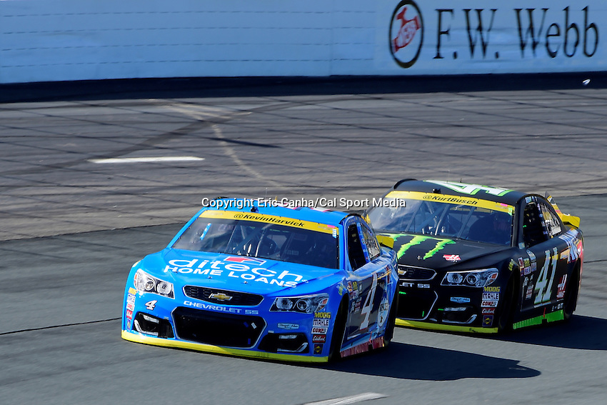Sunday, September 25, 2016: Sprint Cup Series driver Kevin Harvick (4) leads driver Kurt Busch (41) into a turn at the NASCAR Sprint Cup Series Bad Boy Off Road 300 race held at the New Hampshire Motor Speedway in Loudon, New Hampshire. Sprint Cup Series driver Kevin Harvick (4) won the race. Eric Canha/CSM