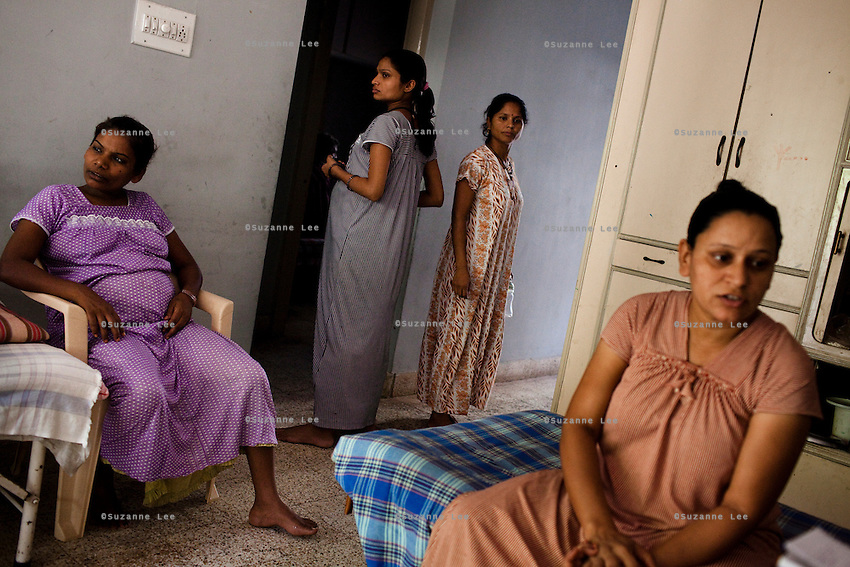 Women lounge around the surrogate house for their entire term of pregnancy...Ranju Rajabhai (extreme right), 32, has enrolled in the program because her husband had sustained 25% burns in a domestic kitchen accident and needs surgery. She will use the money to pay for the medical bills and build a house. She hasn't told her kids. The biological parents of the baby are Canadian...The Akanksha Infertility Clinic in Anand, Gujarat, India, is known internationally for its surrogacy program and currently has over a hundred surrogate mothers pregnant in their environmentally controlled surrogate houses.