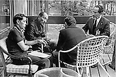 President Anwar Sadat of Egypt, center left, confers with Foreign Minister Muhammad Ibrahim Kamal of Egypt, right, Deputy Premier Hassan Tohami of Egypt, right center, and Osama Al Baz, Ambassador of Egypt to the U.S., left, at Camp David, near Thurmont, Maryland on Tuesday, September 12, 1978..Credit: White House via CNP
