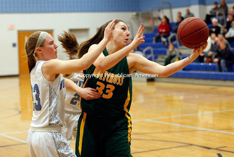 Oxford, CT- 21 January 2016-012116CM08- Holy Cross' Caitlyn Cipriano, right and Oxford's Meghan Sastram go after the ball during their NVL matchup in Oxford on Thursday.    Christopher Massa Republican-American
