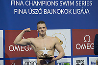 Danas Rapsys of Lithuania celebrates his victory during an awards ceremony after the Men's 400m Freestyle final at the FINA Champions Swim Series at the Danube Arena in Budapest, Hungary on May 12, 2019. ATTILA VOLGYI