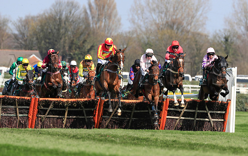 14h April 2018, Aintree Racecourse, Liverpool, England; The 2018 Grand National horse racing festival sponsored by Randox Health, day 3; Horses safely over the first hurdle in The Gaskells Handicap Hurdle