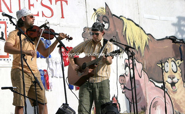 ROXBURY, CT, 08 July 2006- 070806BZ32- David Finch, of New York, NY, on fiddle, and Craig Wilson, of New York, NY, on guitar, perform the &quot;Indiana Waltz&quot; at the 32nd annual Pickin 'N Fiddlin Contest in Roxbury Saturday.<br /> Jamison C. Bazinet Republican-American