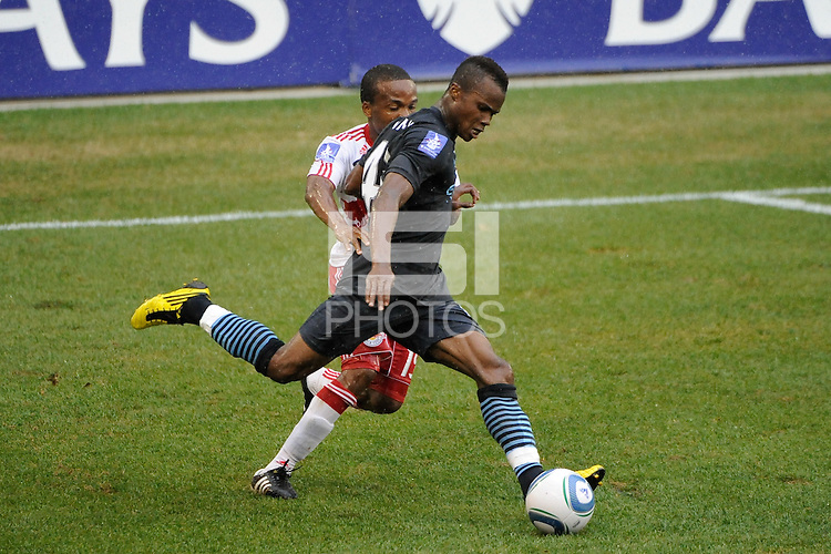Alex Tchuimeni-Nimely (43) of Manchester City F. C. i smarked by Dane Richards (19) of the New York Red Bulls. The New York Red Bulls defeated Manchester City F. C.2-1 during a Barclays New York Challenge match at Red Bull Arena in Harrison, NJ, on July 25, 2010.