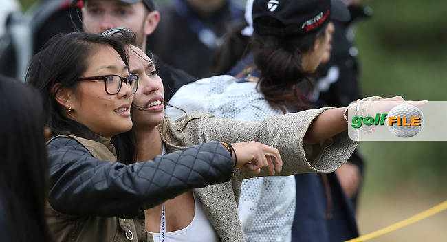 Asian spectators during Round Two of the 144th Open, played at the Old Course, St Andrews, Scotland. /17/07/2015/. Picture: Golffile   David Lloyd<br /> <br /> All photos usage must carry mandatory copyright credit (&copy; Golffile   David Lloyd)