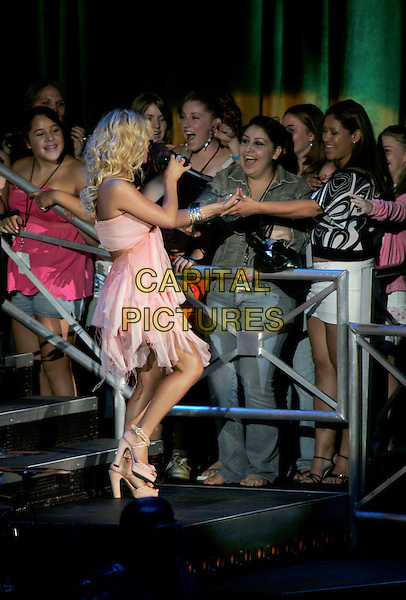 JESSICA SIMPSON.Performs live during her Reality Tour 2004 at The Pacific Ampitheatre in Costa Mesa, California .July 31,2004 .stage, music, concert, gig, singing, full length, pink dress, flowing, layered, fans, crowd, platform shoes.www.capitalpictures.com.sales@capitalpictures.com.Supplied By Capital Pictures