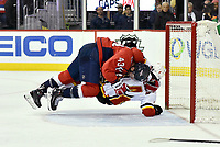 WASHINGTON, DC - FEBRUARY 01: Washington Capitals right wing Tom Wilson (43) takes down Calgary Flames defenseman Rasmus Andersson (4) in the goal crease at the end of an end of game fight during the Calgary Flames vs. the Washington Capitals NHL game on February 1, 2019 at Capital One Arena in Washington, D.C..