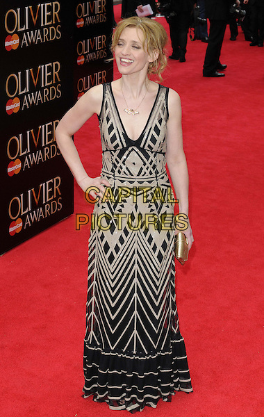 Anne-Marie Duff.The Laurence Olivier Awards 2013, Royal Opera House, Covent Garden, London, England..April 28th, 2013.full length black dress  beige pattern hand on hip.CAP/CAN.©Can Nguyen/Capital Pictures.