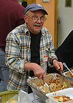 Skip Arthur, working at the food table at the Saugerties Democratic Committee Lasagna Dinner held at the Saugerties Senior Citizens. Center in Saugerties, NY, on Thursday, May 11, 2017.. Photo by Jim Peppler. Copyright Jim Peppler/2017.