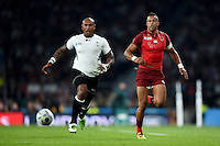 Nemani Nadolo of Fiji and Anthony Watson of England chase after the ball. Rugby World Cup Pool A match between England and Fiji on September 18, 2015 at Twickenham Stadium in London, England. Photo by: Patrick Khachfe / Onside Images