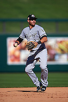 Glendale Desert Dogs third baseman Nicky Delmonico (23) warmup throw to first during an Arizona Fall League game against the Surprise Saguaros on October 23, 2015 at Salt River Fields at Talking Stick in Scottsdale, Arizona.  Glendale defeated Surprise 9-6.  (Mike Janes/Four Seam Images)