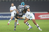 Justin Tipuric of Ospreys is tackled by Peter Betham of Clermont during the Champions Cup Round 1 match between Ospreys and Clermont at The Liberty Stadium, Swansea, Wales, UK. Sunday 15 October 2017