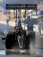 Jul. 17, 2010; Sonoma, CA, USA; NHRA top fuel dragster driver Terry McMillen drives through the waterbox prior to his burnout during qualifying for the Fram Autolite Nationals at Infineon Raceway. Mandatory Credit: Mark J. Rebilas-