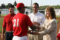June 19, 2009:  Naomi Silver presents LaCurtis Mayes with his championship ring as Cardinals General Manager John Mozeliak and Ryan Crotin look on during a ceremony to award the 2008 NY-Penn League Champions before a game at Dwyer Stadium in Batavia, NY.  The Batavia Muckdogs are the NY-Penn League Short Season Class-A affiliate of the St. Louis Cardinals.  Photo by:  Mike Janes/Four Seam Images