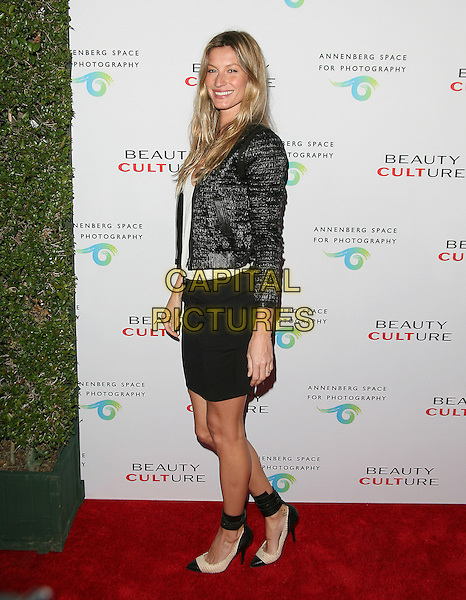 GISELE BUNDCHEN .at The opening of Beauty Culture - a photographic exploration of how feminine beauty is defined, challenged and revered in modern society held at Annenberg Space for Photography in Century City, California, USA,  .May 19th 11..full length skirt top bag chanel side shoes ankle strap two tone beige  black  jacket white                                                               .CAP/RKE/DVS.©DVS/RockinExposures/Capital Pictures.