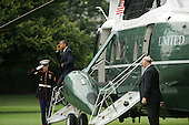 United States President Barack Obama (R) salutes a US Marine (L) as he walks off Marine One on the South Lawn of the White House before delivering remarks on passage of sweeping financial reform legislation, in Washington DC, USA, Thursday, 15 July 2010.  The US Senate passed the Restoring American Financial Stability Act of 2010, 15 July 2010, which is aimed at reforming Wall Street.  .Credit: Michael Reynolds - Pool via CNP